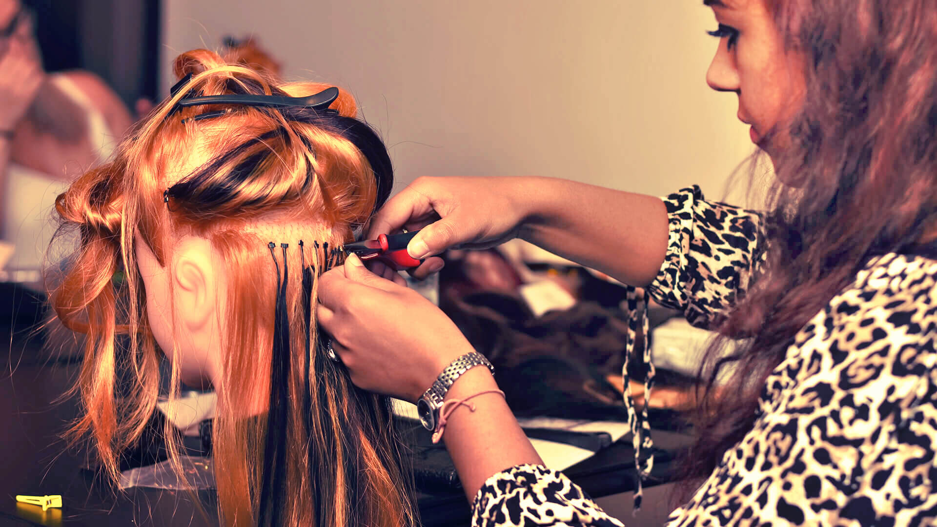 Image of hair extension technician working